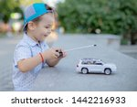 A Boy Playing With A Car Remote....