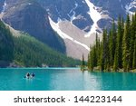 boating at beautiful moraine... | Shutterstock . vector #144223144