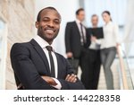 smiling businessman with his... | Shutterstock . vector #144228358