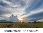 sunset with dramatic sky | Shutterstock . vector #144238024