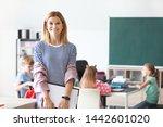 Portrait Of Female Teacher In...