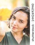 autumn   fun girl holds a... | Shutterstock . vector #1442692940