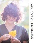 autumn   fun girl holds a... | Shutterstock . vector #1442721869