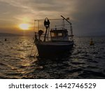 Fishing Boat Anchored On The...