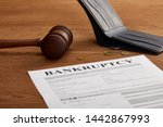 Bankruptcy Form With Wooden...