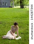 beautiful girl reading in...   Shutterstock . vector #144287344