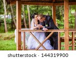 wedding shot of bride and groom ... | Shutterstock . vector #144319900