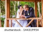 wedding shot of bride and groom ... | Shutterstock . vector #144319954