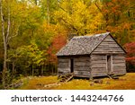 Grear Smoky Mountains National Park, Tennessee - an historic log home in a hardwood forest with autumn fall colors