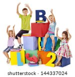 children sitting at cube hand... | Shutterstock . vector #144337024