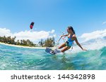 kite boarding  fun in the ocean ... | Shutterstock . vector #144342898