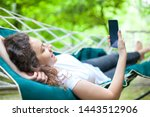 summer day  young woman lying... | Shutterstock . vector #1443512906