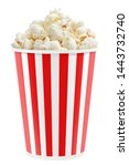 Delicious popcorn in a red striped paper cup, isolated on white background