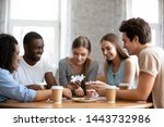 Stock photo involved interested happy smiling mixed race friends sitting together at table drinking coffee and 1443732986