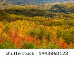 Small photo of View fron the foothills parkway of hills with trees showing autumn fall colors. The Foothills Parkway is a national parkway which traverses the foothills of the Great Smoky Mountains inTennesse