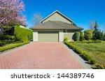 double doors garage with nicely ...   Shutterstock . vector #144389746