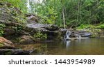 Scenic view of rock formations and lush forest in Devil