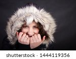 Stock photo black haired woman in black jacket with fur hood 1444119356