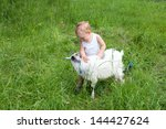 Adorable Child Is Cuddling A...