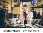 Stock photo happy businesswoman talking on the phone woman in cafe use mobile phone working on notebook 1444516016