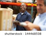 manager in warehouse with... | Shutterstock . vector #144468538