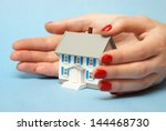 A professional woman ensures that your property is covered by good hands. - stock photo