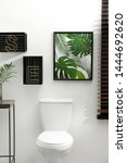 picture and shelves near toilet ... | Shutterstock . vector #1444692620