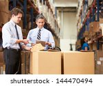 businessmen checking boxes with ... | Shutterstock . vector #144470494