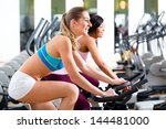 women in the gym on fitness... | Shutterstock . vector #144481000