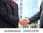 handshake on background of... | Shutterstock . vector #144511550