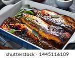 Stock photo close up of delicious roasted fillets of mackerel fish in a baking dish on a concrete kitchen table 1445116109