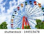 Giant Ferris Wheel Against Blu...