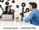 two radio hosts moderating a... | Shutterstock . vector #1445266706