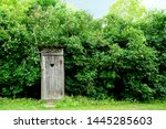Wooden Rustic Toilet On Green...
