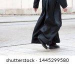 Catholic Priest In The Black...