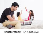 father working on the laptop... | Shutterstock . vector #144536363