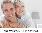 affectionate couple smiling at...   Shutterstock . vector #144559193