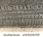 tire tracks on dirt ground or... | Shutterstock . vector #1445635259