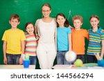 line of cute schoolchildren... | Shutterstock . vector #144566294