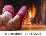 relaxing at the fireplace on... | Shutterstock . vector #144573008