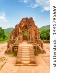View of red brick temple of My Son Sanctuary among green woods in Da Nang (Danang), Vietnam. My Son is a complex of partially ruined ancient Hindu temples constructed by the kings of Champa.