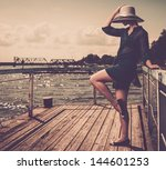 stylish woman in white hat... | Shutterstock . vector #144601253