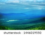 Scandinavian panorama. Northern Scandinavian swamps and boreal coniferous forest on plateaus (fjel). Characteristic glacial kettle basin with river and lakes. Glaciated landscape