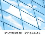 clouds reflected in windows of... | Shutterstock . vector #144633158
