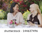 Two Smiling Multiethnic Women...