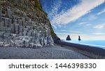 Small photo of Amazing landscape with basalt rock formations Troll Toes on Black beach Reynisfjara near the village of Vik. Location: Reynisfjara Beach, Vik Village, Iceland (Sudurland), Europe