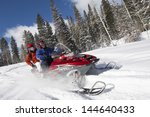 Couple Driving Snowmobile On...