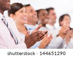 happy business group applauding ... | Shutterstock . vector #144651290