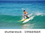 young boy surfing the wave in a ... | Shutterstock . vector #144664664