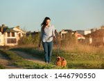 Stock photo young woman walking her adorable brussels griffon dogs outdoors 1446790550
